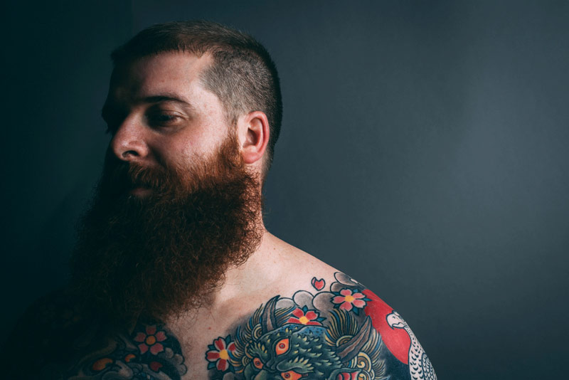 Bearded Tattooed Man | How Do You Know When To Trim Your Beard?