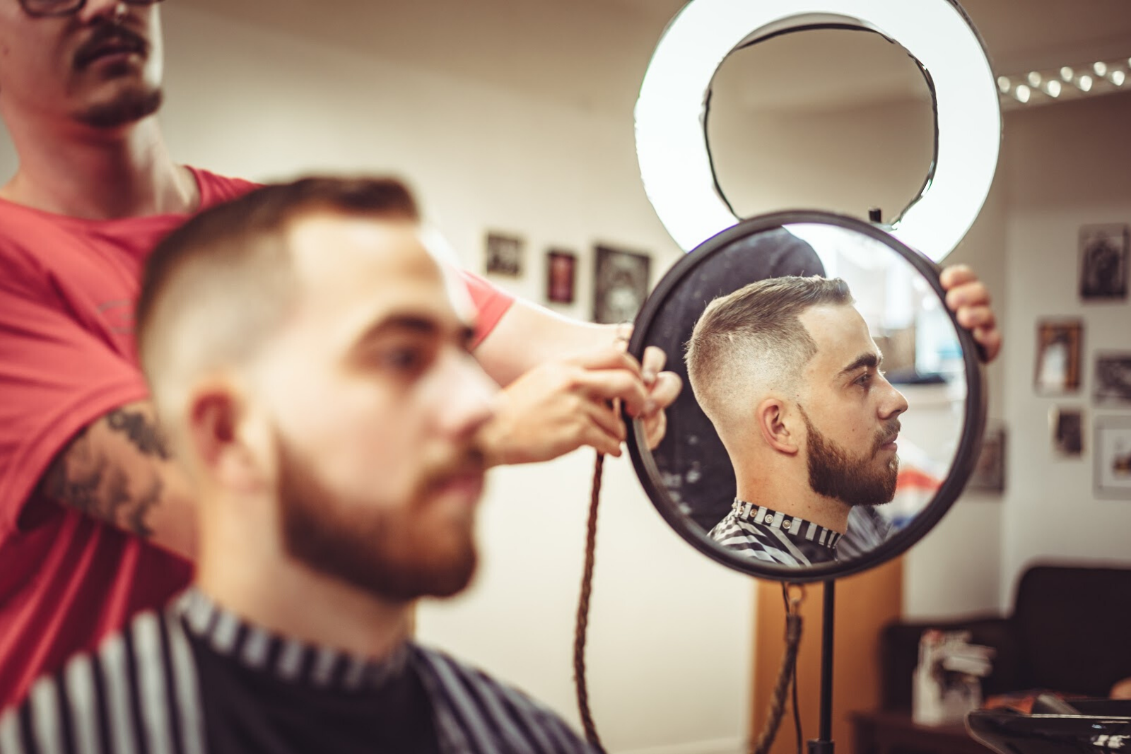 Man Having a Haircut | 10 Added Benefits Of A Professional Beard Trim